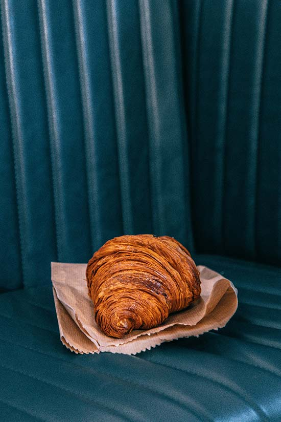croissant on a blue leather seat